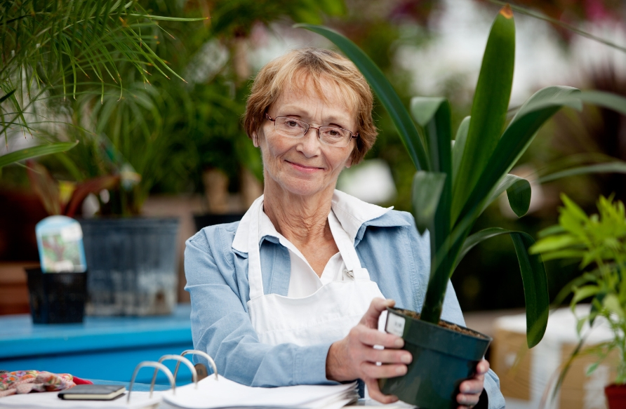woman tending to her plants in retirement